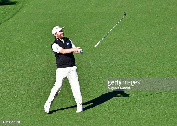 Branden Grace of South Africa tosses his club after a Eagle on No 15 during the second round of the Masters at Augusta National Golf Club Friday...