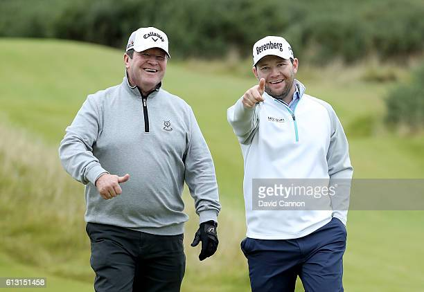 Branden Grace of South Africa walks off the 11th tee with his father Peter Grace during the second round of the Alfred Dunhill Links Championship on...