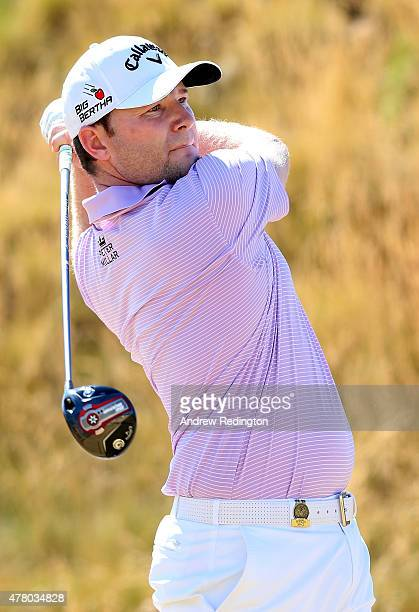Branden Grace of South Africa watches his tee shot on the seventh hole during the final round of the 115th US Open Championship at Chambers Bay on...