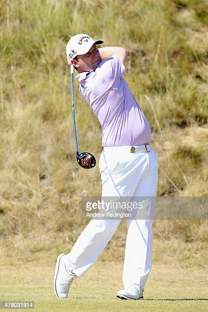 Branden Grace of South Africa watches his tee shot on the sixth hole during the final round of the 115th US Open Championship at Chambers Bay on June...