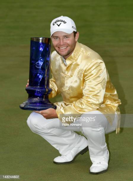 Branden Grace of South Africa with the winners trophy after the final round of the Volvo China Open at the Binhai Lake Golf Course on April 22, 2012...