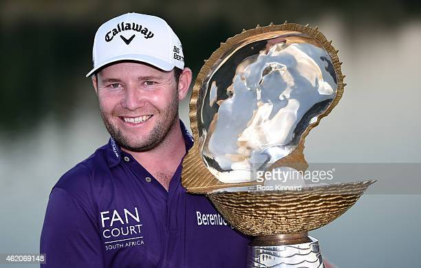 Branden Grace of South Africa with the winners trophy after the final round of the Commercial Bank Qatar Masters at the Doha Golf Club on January 24...