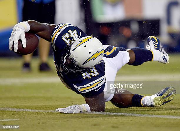 Branden Oliver of the San Diego Chargers dives over the line to score a touchdown for a 147 lead over the Dallas Cowboys during the second quarter at...