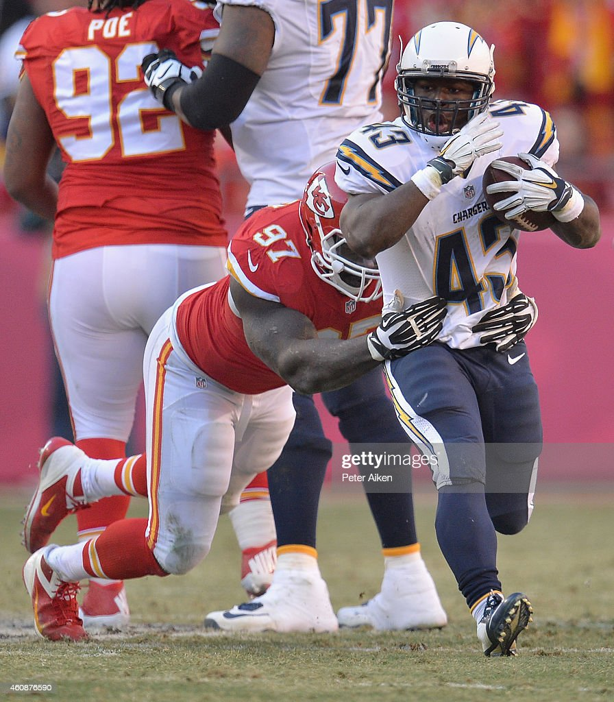 Branden Oliver #43 of the San Diego Chargers runs the ball against Allen Bailey #97 of the Kansas City Chiefs during the game at Arrowhead Stadium on December 28, 2014 in Kansas City, Missouri.