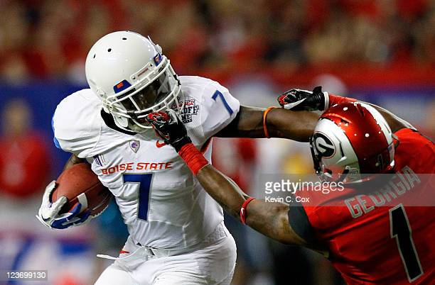 Branden Smith of the Georgia Bulldogs is called for a facemask while tackling D.J. Harper of the Boise State Broncos at Georgia Dome on September 3,...