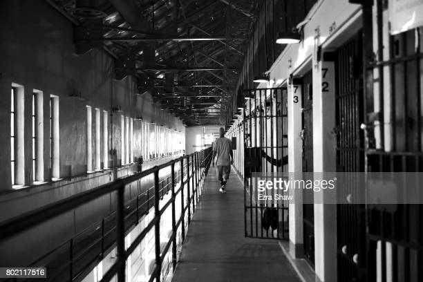 Branden Terrel walks down the hallway near his cell on June 8 2017 in San Quentin California Branden Terrel was sentenced to 11 years in state prison...