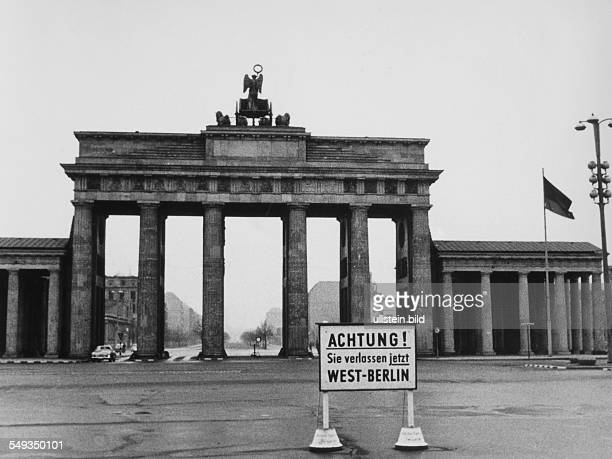Brandenburg Gate 1960 seen from the West Sign warning Attention you are now leaving West Berlin
