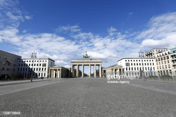 Brandenburg Gate and its surroundings are seen empty after gathering of more than two people has been prohibited and shops have been closed in the...
