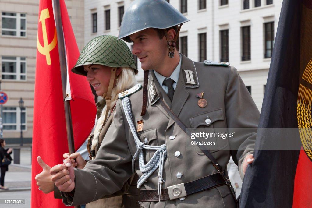 Brandenburg Gate Couple Wearing Soviet East German Uniform