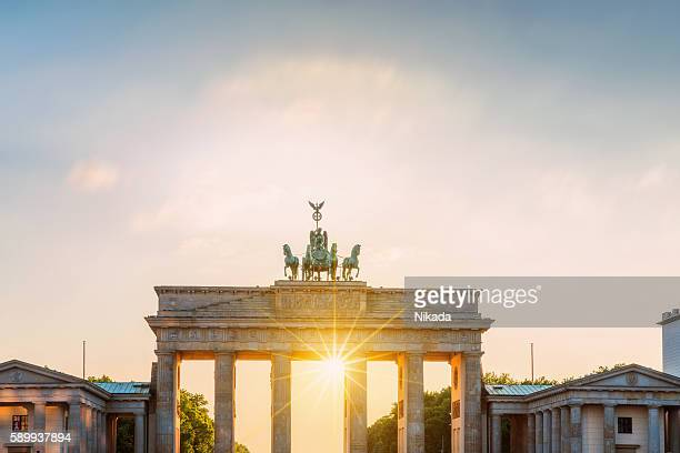 Brandenburg Gate with sun, Berlin, Germany