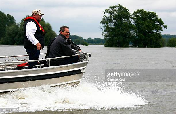Brandenburg state Governor Matthias Platzeck and state Interieur Minister Rainer Speer drive in a boat during a sighting of the river Oder on May 27...