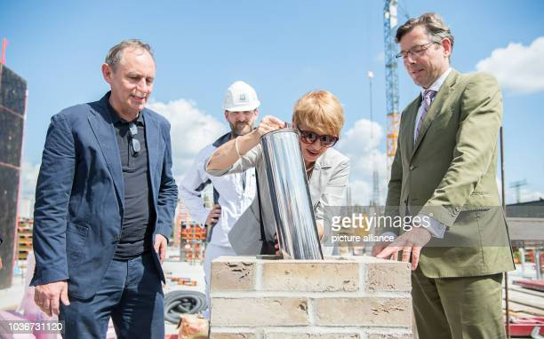 Brandenburg State Minister of Science Martina Muench places the time capsule in the foundation stone at the groundbreaking for the new Central Art...