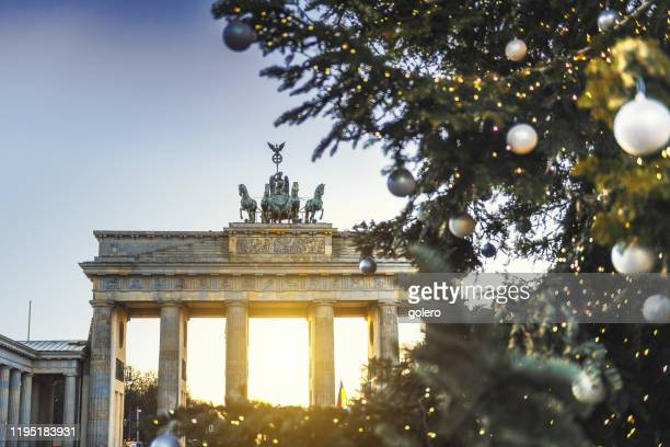 brandenburger tor behind christmas tree - berlin stock pictures, royalty-free photos & images