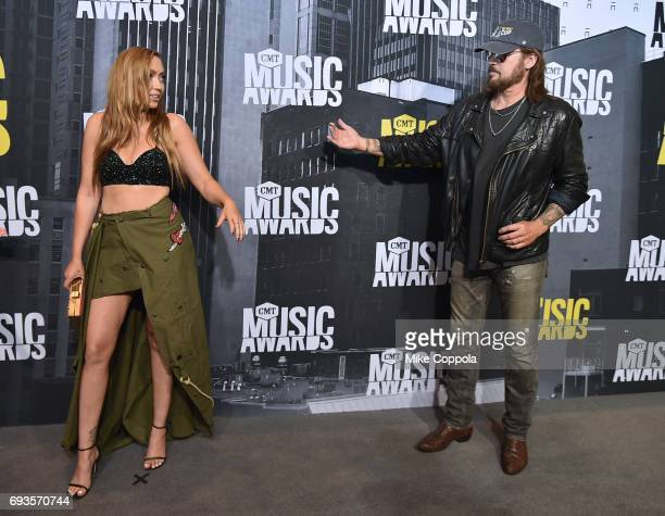 Brandi and Billy Ray Cyrus attend the 2017 CMT Music Awards at the Music City Center on June 7 2017 in Nashville Tennessee