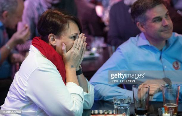 Brandi Bergstrom reacts as CNN predicts Republicans will maintain control of the Senate during an election viewing party at a bar called Piano Fight...