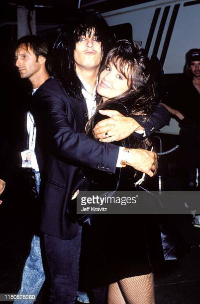 Brandi Brant and Nikki Sixx at the 1990 MTV Video Music Awards at in Los Angeles California
