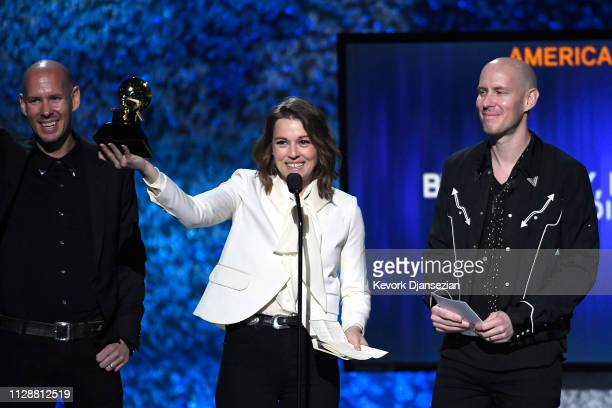 Brandi Carlile accepts Best Americana Album for 'By the Way I Forgive You' with Phil Hanseroth and Tim Hanseroth at the premiere ceremony during the...