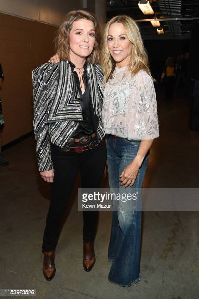 Brandi Carlile and Sheryl Crow attend the 2019 CMT Music Awards Backstage Audience at Bridgestone Arena on June 05 2019 in Nashville Tennessee