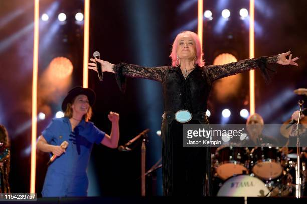Brandi Carlile and Tanya Tucker perform on stage during day 1 of 2019 CMA Music Festival on June 6 2019 in Nashville Tennessee