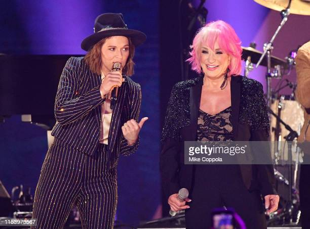 Brandi Carlile and Tanya Tucker perform the 2019 CMT Music Awards Backstage Audience at Bridgestone Arena on June 05 2019 in Nashville Tennessee
