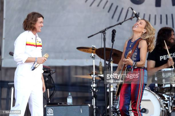 Brandi Carlile performs with Sheryl Crow during day one of the 2019 Newport Folk Festival at Fort Adams State Park on July 26 2019 in Newport Rhode...