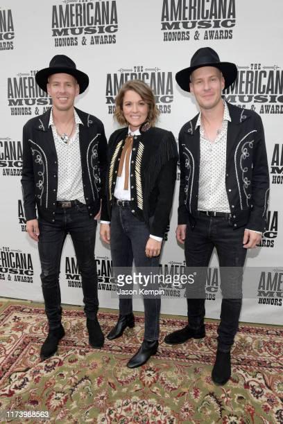 Brandi Carlile Phil Hanseroth and Tim Hanseroth attend the 2019 Americana Honors Awards at Ryman Auditorium on September 11 2019 in Nashville...