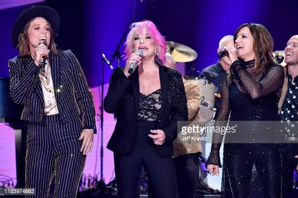 Brandi Carlile Tanya Tucker and Martina McBride perform at the 2019 CMT Music Awards at Bridgestone Arena on June 05 2019 in Nashville Tennessee