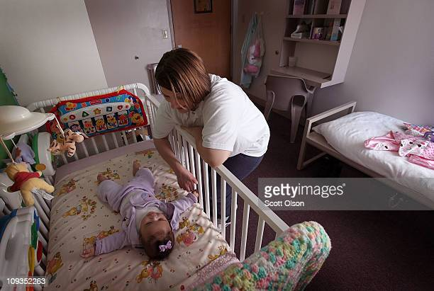 Brandi Ceci puts her threemonthold daughter Alexis down for a nap in her room at the Decatur Correctional Center February 18 2011 in Decatur Illinois...
