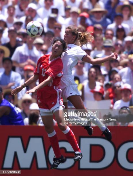 S WORLD CUP FINAL US Brandi Chastain and China's Pu Wei in WWC final 7/10/99