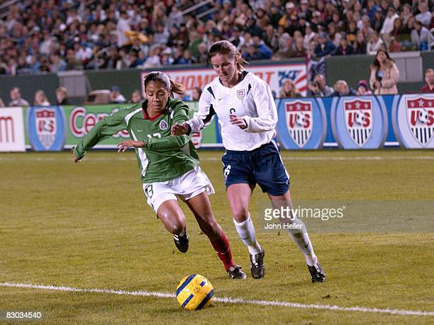 Brandi Chastain for USA and a Mexico Player during the Fan Celebration Tour finale on December 8 2004 at The Home Depot Center in Carson California