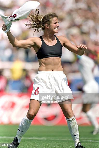 Brandi Chastain of Team USA celebrates during the Women's World Cup against Team China at The Rose Bowl on July 10 1999 in Pasadena California Team...