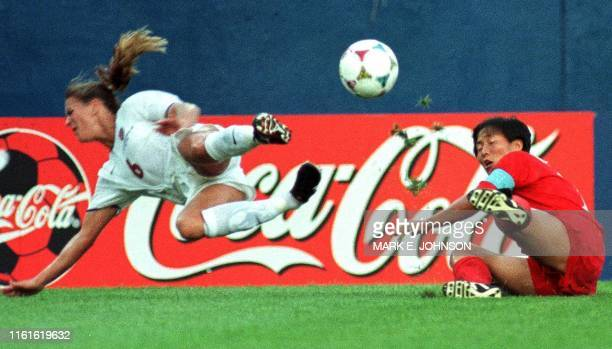 Brandi Chastain of the US and Kum Sil Kim of North Korea battle for a ball in the first half of their 1999 FIFA Women's World Cup match at Foxboro...
