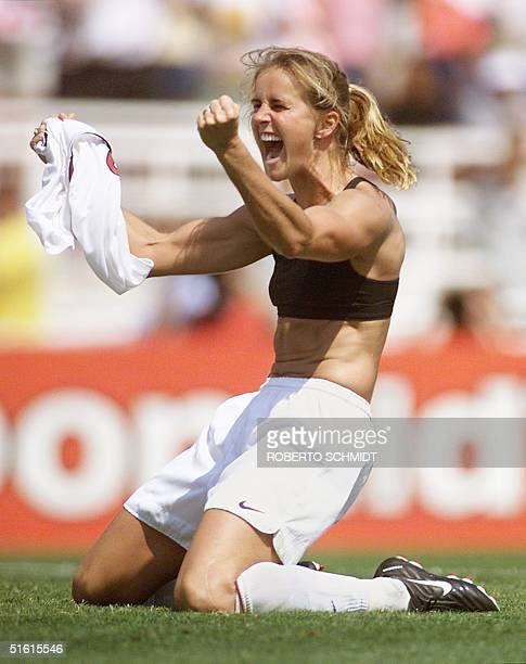 Brandi Chastain of the US celebrates after kicking the winning penalty kick to win the 1999 Women's World Cup final against China 10 July 1999 at the...