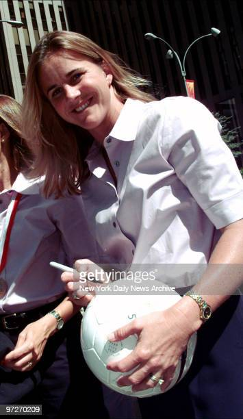 Brandi Chastain of the US Women's World Cup Soccer Team autographs ball during visit to New York Chastain scored the winning goal in the Women's...