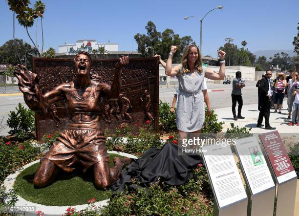 Brandi Chastain poses with statue of herself during an unveiling of a statue honoring the United States win at 1999 Women's World Cup on July 10,...