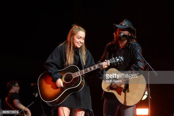 Brandi Cyrus and Billy Ray Cyrus appear on the Cracker Barrel Stage during CMA Fest on June 8 2017 in Nashville Tennessee