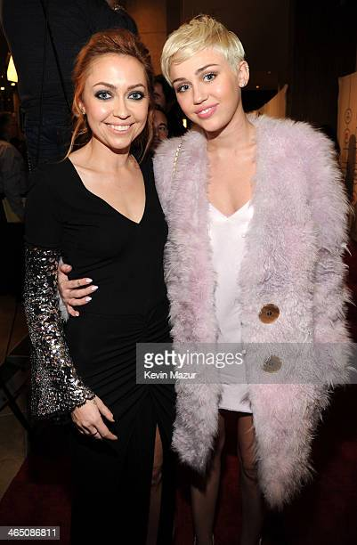Brandi Cyrus and Miley Cyrus attend the 56th annual GRAMMY Awards PreGRAMMY Gala and Salute to Industry Icons honoring Lucian Grainge at The Beverly...
