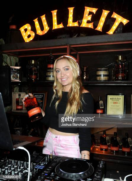 Tattoo Artist Shawn Barber shows off his latest ink on the Bulleit Bourbon Tattoo Edition bottle with Bulleit Bourbon Founder Tom Bulleit on July 17...