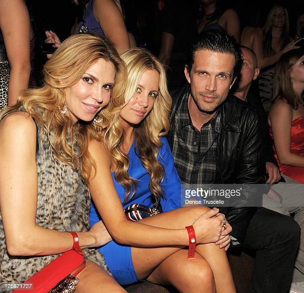 Brandi Glanville and Ashley Hamilton attend the fifth anniversary party of TAO Nightclub at the Venetian on November 6 2010 in Las Vegas Nevada