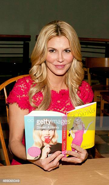 Brandi Glanville signs copies of her new book at Book Revue on February 12 2014 in Huntington New York