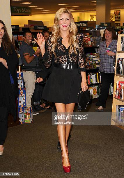 Brandi Glanville signs copies of her new book 'Drinking Dating' at Barnes Noble bookstore at The Grove on February 19 2014 in Los Angeles California
