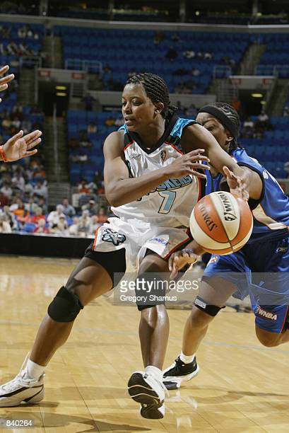 Brandi McCain of the Cleveland Rockers is defended by Shannon Johnson of the Orlando Miracle in the game on June 19 2002 at Gund Arena in Cleveland...