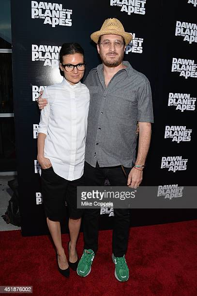 Brandi Milbradt and director Darren Aronofsky attend the Dawn Of The Planets Of The Apes premiere at Williamsburg Cinemas on July 8 2014 in New York...