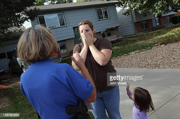 Brandie Barbiere reacts as Weld County sheriff's deputy Mary Schwartz arrives to evict her and her family from their home on October 5, 2011 in...