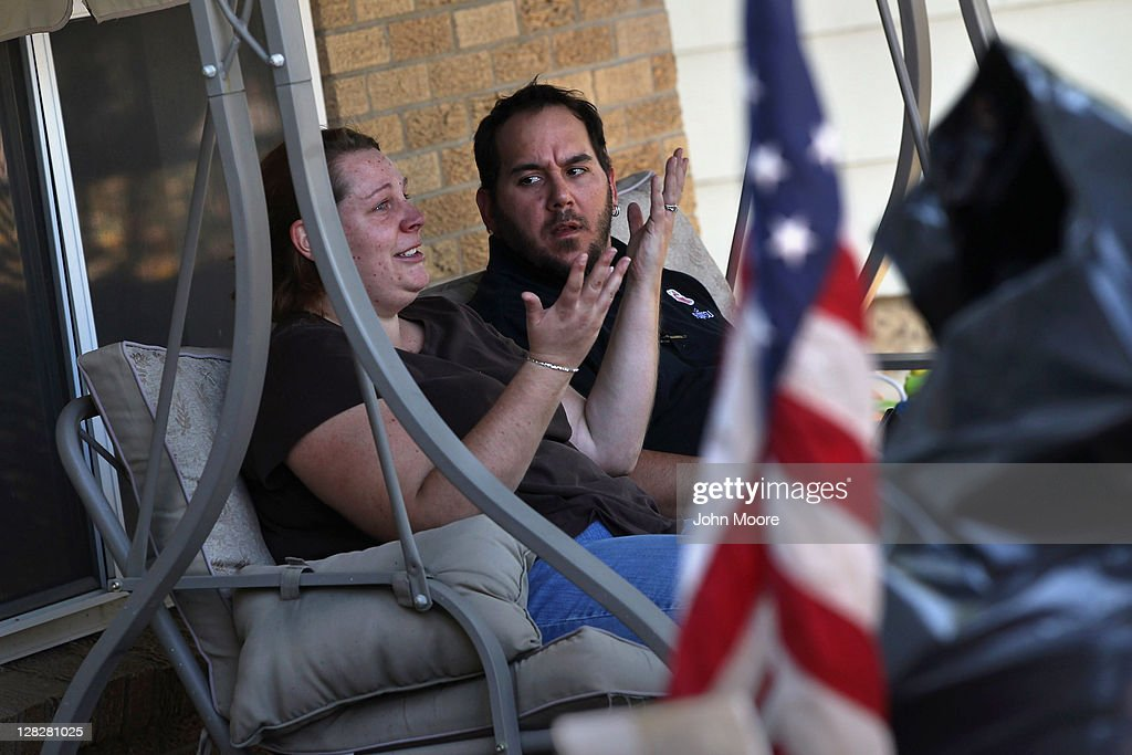 Brandie Barbiere (L) tries to explain to her husband Dan Barbiere why their home was foreclosed upon on October 5, 2011 in Milliken, Colorado. Brandie said she had stopped making the mortgage payments 11 months before, after she lost more than half her home child care business due to the continued weak economy. Her husband Dan, a fulltime air conditioning distributor, did not learn of the situation until he returned home to find his family evicted, their household possessions removed to the front lawn and the home repossesed by the bank. A nationwide glut of foreclosed homes is expected to depress U.S. housing values for years.