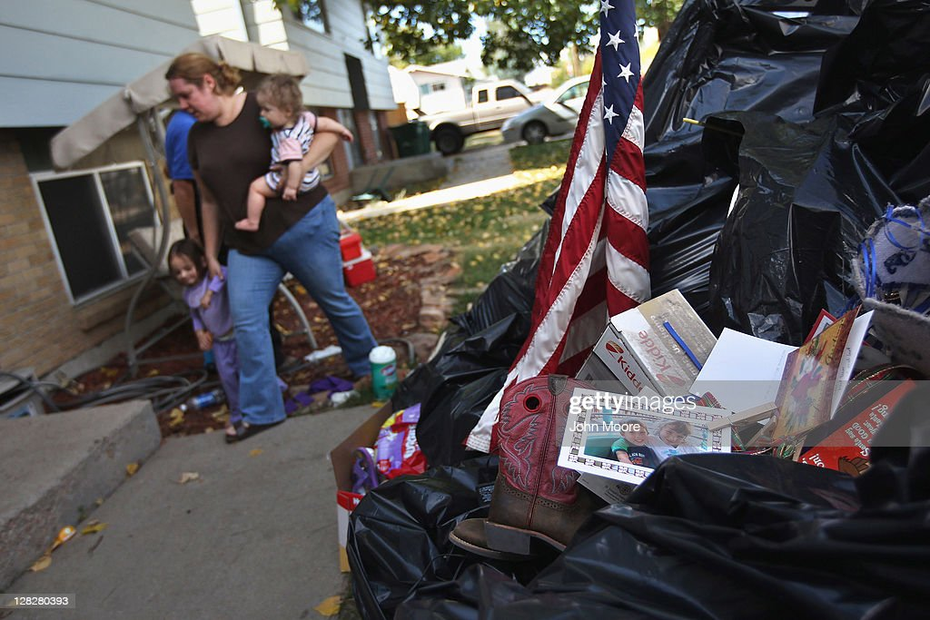 Brandie Barbiere walks past her household possessions after they were removed to her front yard during a home foreclosure on October 5, 2011 in Milliken, Colorado. Barbiere said she had stopped making the mortgage payments 11 months before, after she lost more than half her home child care business due to the continued weak economy. A nationwide glut of foreclosed homes is expected to depress U.S. housing values for years.