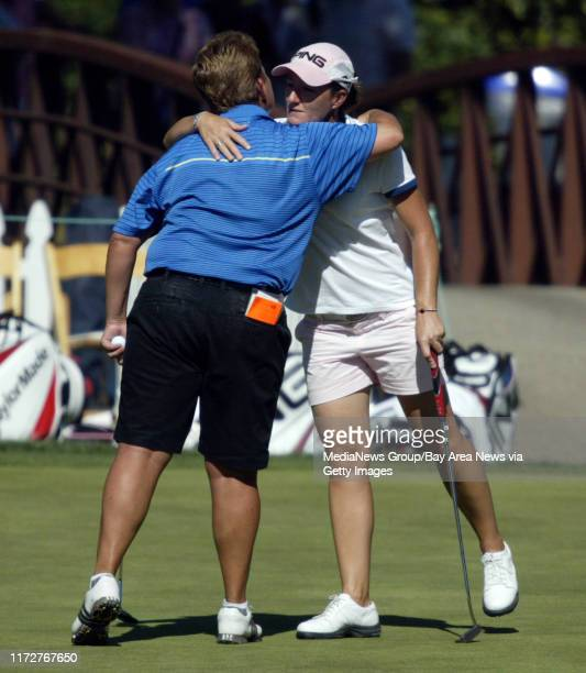 Brandie Burton, left, and Gwladys Nocera, right, hug on the 18th green after finishing their second round play at the CVS/pharmacy LPGA Challenge, in...
