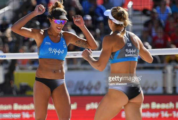 Brandie Wilkerson and Heather Bansley of Canada celebrate after winning a point against Melissa Humana-Paredes and Sarah Pavan of Canada during the...