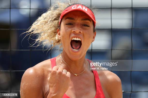 Brandie Wilkerson of Team Canada celebrates against Team Argentina during the Women's Preliminary - Pool C beach volleyball on day four of the Tokyo...