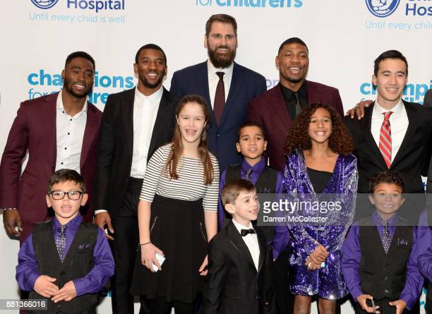 Brandin Cooks Malcolm Mitchell Sebastian Vollmer Marcus Smart and Justin Doo with the kids at Champions for Children's benefitting Boston Children's...